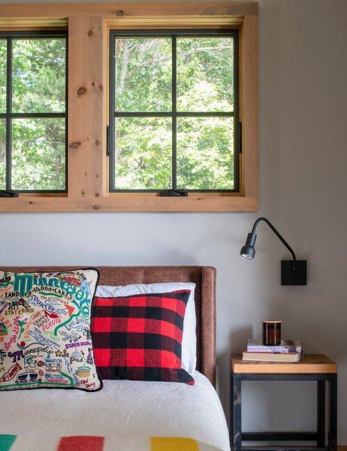 modern lakefront cabin bedroom