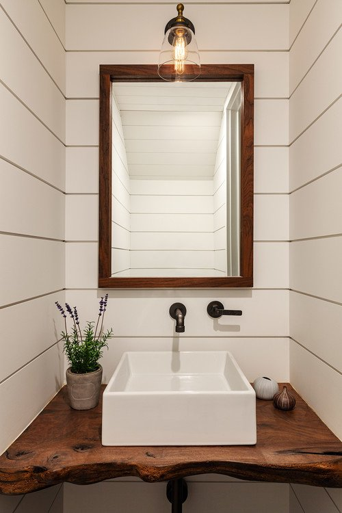 Small powder room with white shiplap walls and live edge vanity