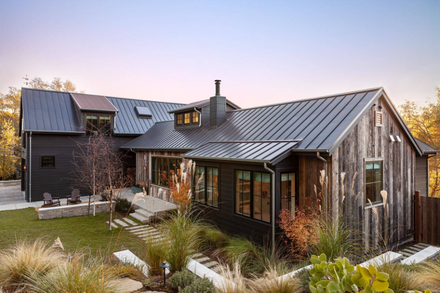 Rustic modern farmhouse with mix of exterior siding - clapboard and barn wood