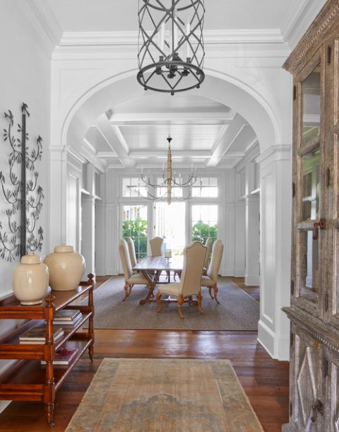 Elegant Southern Dining Room with Arched Hallway